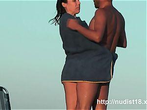 gorgeous nudist honeys filmed toying on the bare beach