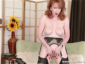 busty red finger screws puss in garter nylons and pumps